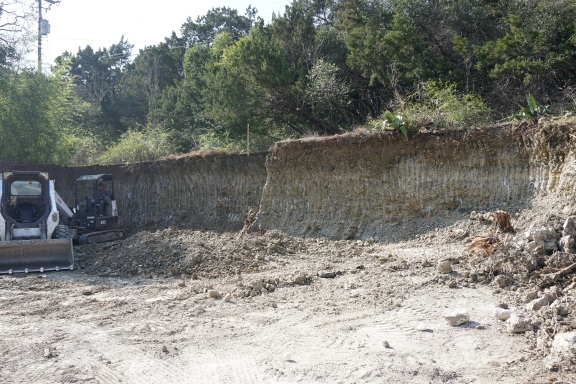 Making cuts in the back of the site for the retaining wall